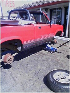 My beloved 1989 Dodge Dakota in its original condition. Here it is getting new shoes. The original wheels were pretty bad, but not as bad as the paint.