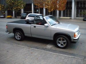 "Once I searched ""Dodge Dakota Convertible"" in Google searching for parts. Up came this photo of me driving down Congress Avenue at Christmas time. There were many more times I found random pictures of my truck on the internet. It was like that Drag Queen Leslie. This truck WAS Austin"